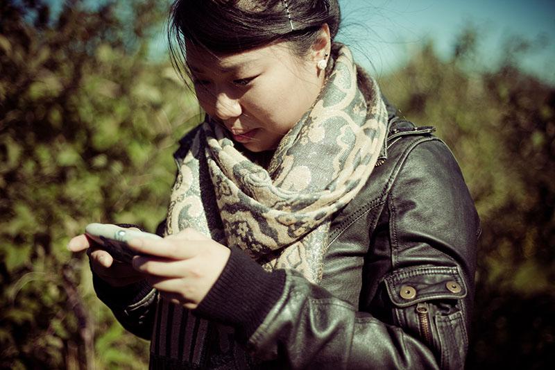 asian-girl-checking-cellphone